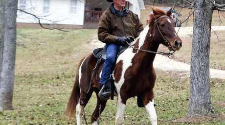 US senate candidate Roy Moore rides a horse to vote during the Alabama election on Tuesday. Picture: AP Photo/Brynn Anderson