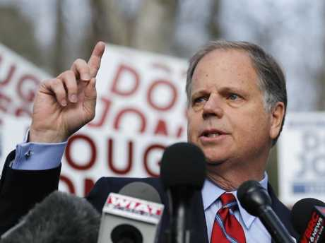 Democratic candidate Doug Jones speaks to reporters after casting his ballot. Picture: AP Photo/John Bazemore