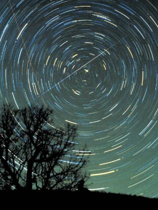 Star trails and a Geminid meteor over Brasstown Bald mountain, Georgia, in 1985. Picture: NASA website
