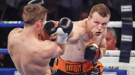 Jeff Horn smashes a right through Gary Corcoran's defences.