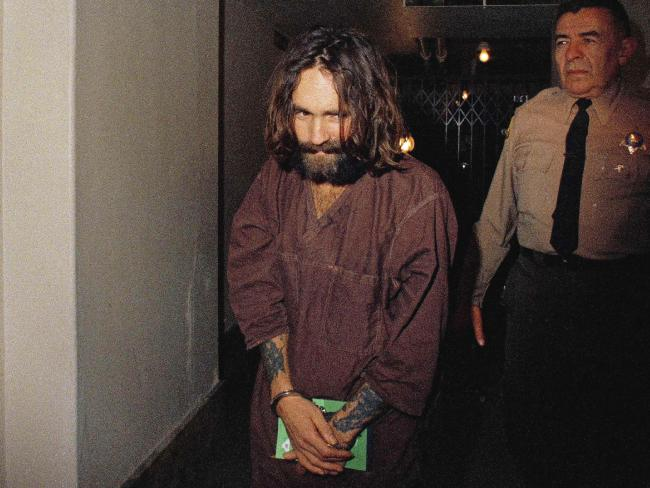 In this 1969 file photo, Charles Manson is escorted to court in Los Angeles during an arraignment phase. Picture: AP.