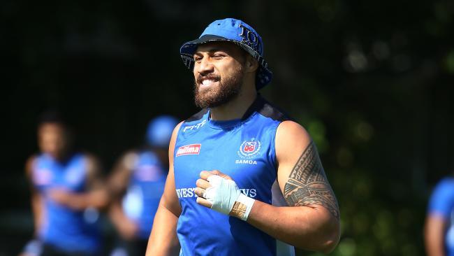Sam Tagatese trains with his Tonga World Cup teammates.