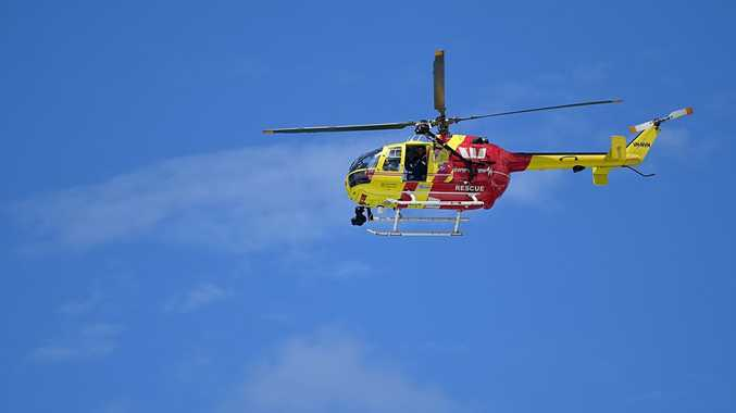 Westpac Rescue Helicopter on patrol off Coolum Beach.