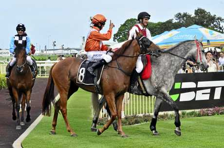 Nozi Tomizawa celebrates his win on Sylpheed in last Saturday's Listed Just Now Quality at Doomben.