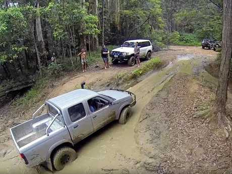 A driver negotiates a section of hinterland forestry track known by four-wheel-drive enthusiasts as the Mud Mile.