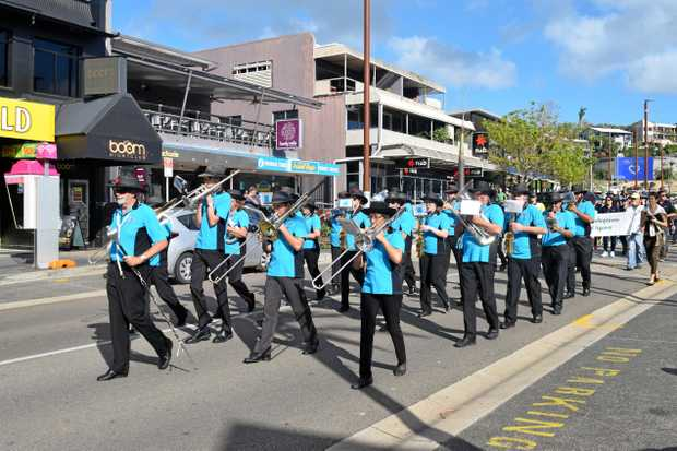 The Proserpine Citizens Band added to the Anzac atmosphere on Airlie Main Street.