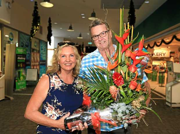 ACT OF KINDNESS: Kingscliff Shopping Centre operations manager John Miller presents some flowers to Chris Harding who returned a lost wallet found at the centre with $1000 in it.