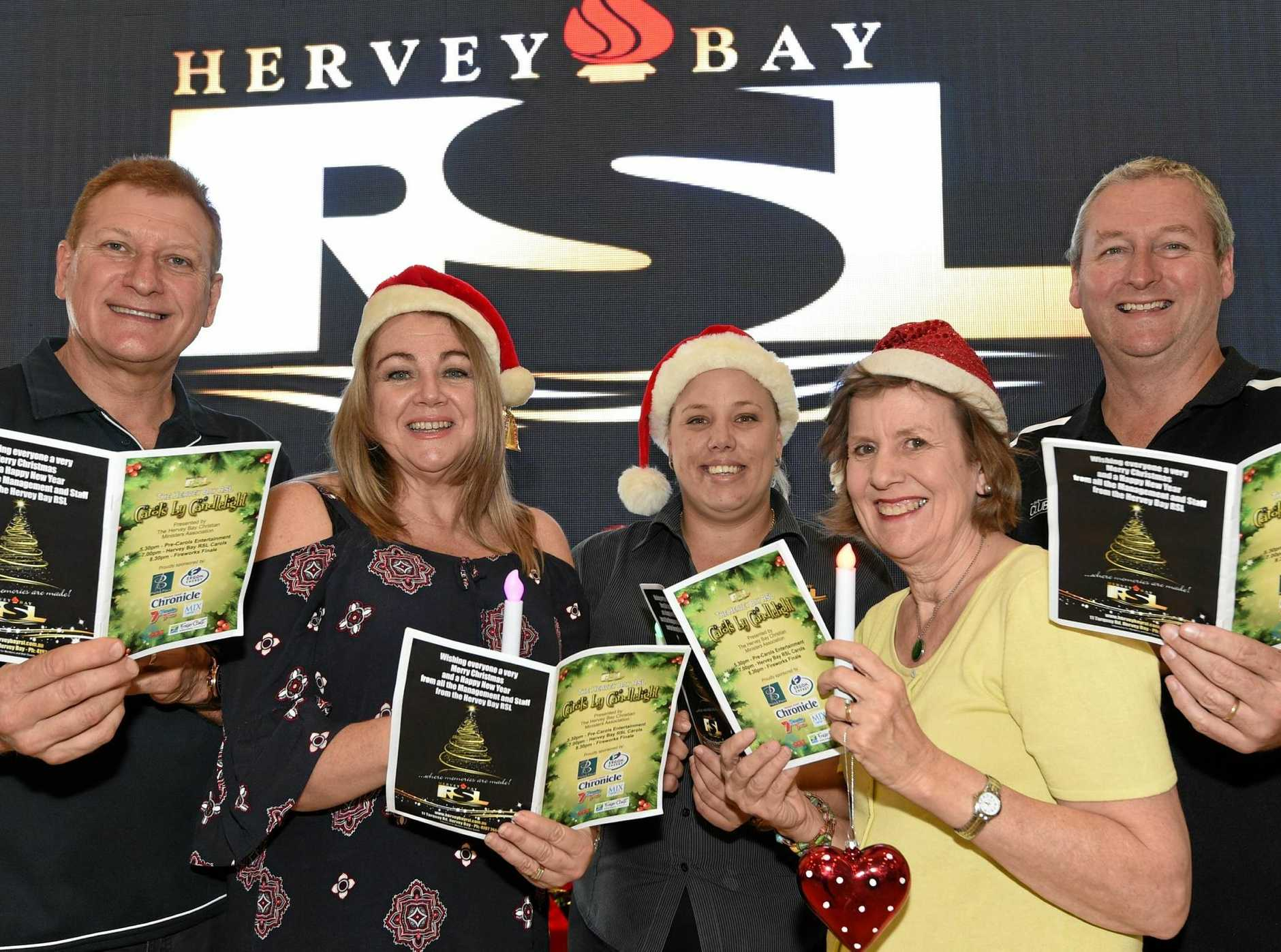 HELPING HANDS: Ross and Mary-Lyn Davie, Sarah Bailey, Julie Terry and Hervey Bay RSL and Services Memorial Club general manager Jason Lynch have been working hard to stage a huge night of carols at Seafront Oval this Saturday.