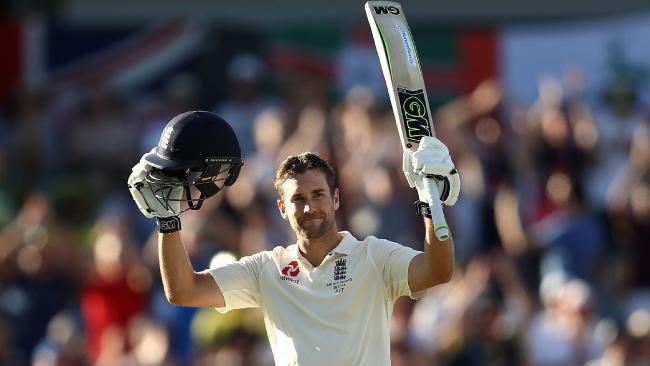 Dawid Malan celebrates England's first century of the series.
