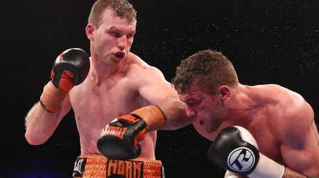 Horn and Corcoran fought a tough fight. (Chris Hyde/Getty Images)