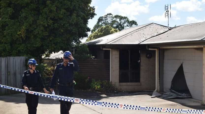 Police scientific officers investigate a fatal house fire in Beerwah Parade at Beerwah.