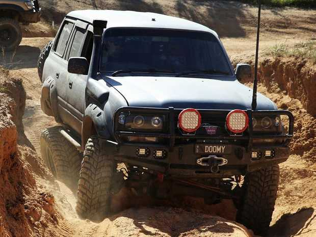 Woombye four wheel drive enthusiast Josh Dumaresq negotiates some difficult terrain in his modified Toyota LandCruiser.