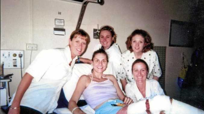 Despite her horrific injuries, Clare Sultmann was able to smile for a photo with nurses and hospital staff during one of her long stays in hospital.