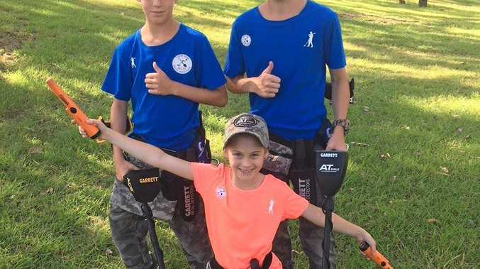 UNEXPECTED GOLDMINE: Andrew, 12, Hailey, 9, and Damien Hepburn, 14, take a look around town for some unexpected metal surprises.