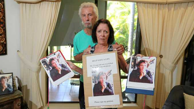 GREAT LOSS: Garry  and Sue Jenkins with photographs of their son, Dann.