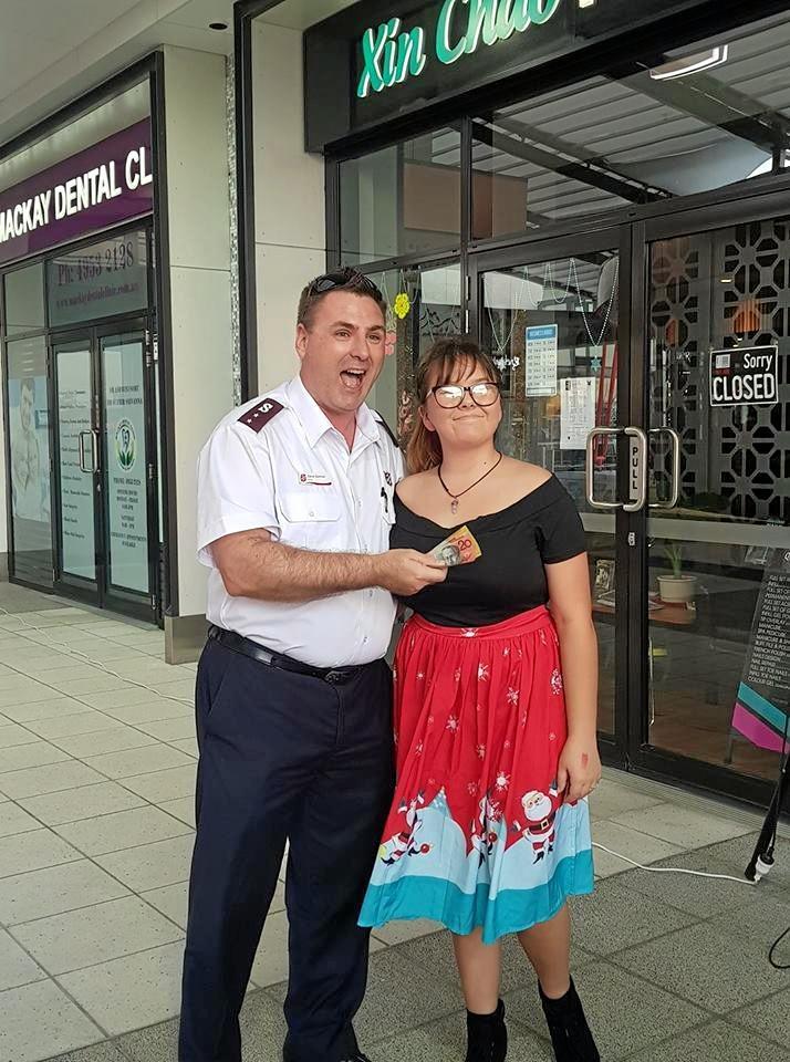 Salvation Army representative Captain Steve Spencer with Zoe McLellan.