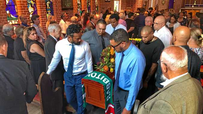 FULL TIME: Draped in the colours of his beloved Rabbitohs, Indigenous leader Sol Bellear is borne out of St Martin's Church in Mullumbimby after his funeral service.