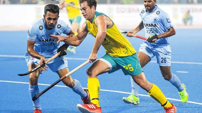 TOP SKILLS: Dylan Wotherspoon takes on Harmanpreet Singh in the Odisha Mens Hockey World League match against India.