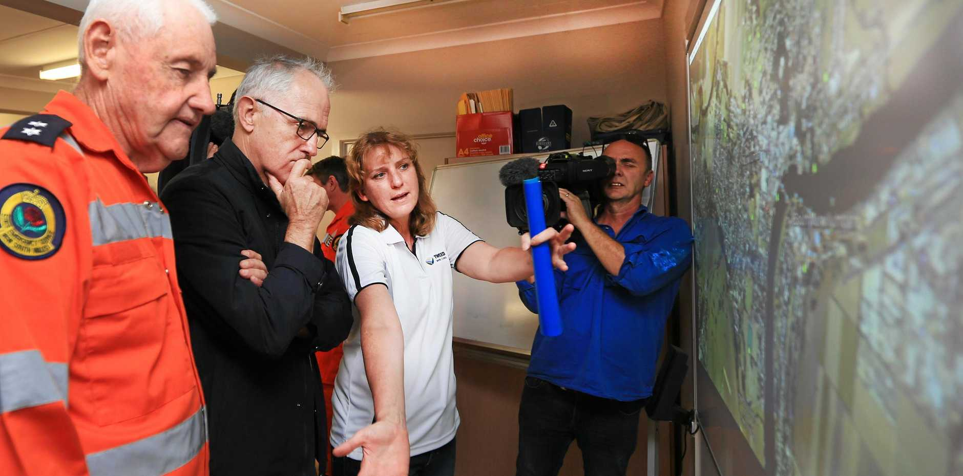 Tweed Shire Council mayor Katie Milne briefs Prime Minister Malcolm Turnbull after the March flooding disaster.