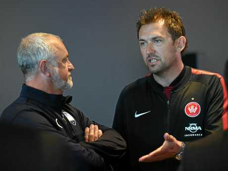 Graham Arnold (left) speaks with Tony Popovic.