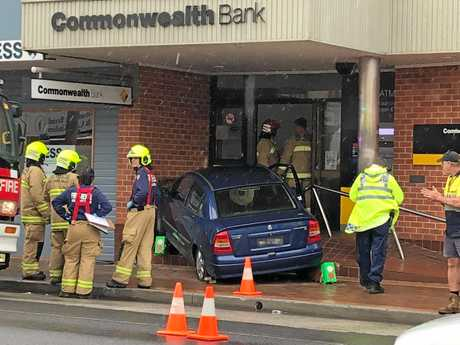 A car which crashed into the Commonwealth Bank building in Maclean this morning. Photo: Sarah Hourigan