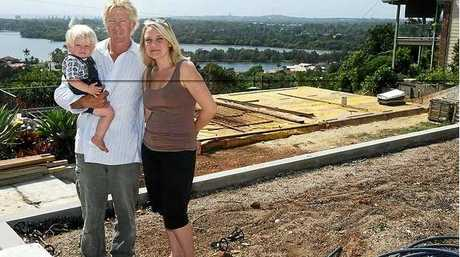 Still smiling despite having to rebuild from scratch their Old Ferry Road house, and with a new happy deadline - another baby on the way - are Chace, Scott and Dominique Adams.