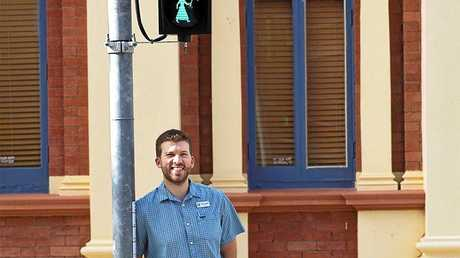 HAPPY CROSSING: Fraser Coast Councillor Paul Truscott with one of the already installed Mary Poppins lights in Maryborough.