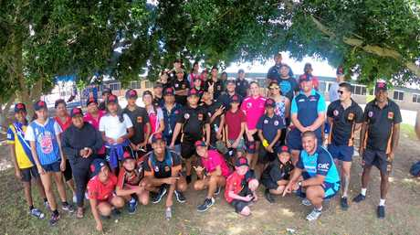 SETTING THE EXAMPLE: Yamba rugby union star Cody Walker (front right) visits disadvantaged schools in the Western Plains region.