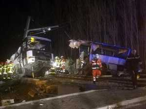 Children killed after their school bus collided with a train