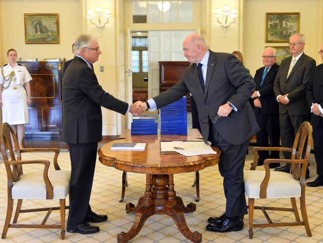 Commissioner Justice Peter McClellan (left) and the Governor-General of Australia Peter Cosgrove at the signing ceremony and the release of the Final report of the Royal Commission into Institutional Responses to Child Sexual Abuse at Government House, Canberra, 15 December, 2017. Photo: Jeremy Piper