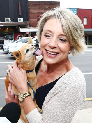Labor candidate Kristina Keneally gets a kiss from Smarty outside the Epping railway station on the last day of campaigning in the Bennelong by-election. Picture: John Feder/The Australian.