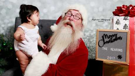 Baby Ava and Santa. Pic by Perfection Photography Queensland.