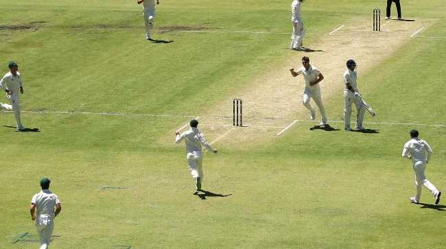 Players celebrate a wicket during the third Test between Australia and England in Perth.
