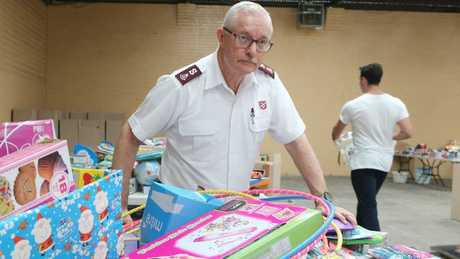 Major Neil Dickson from the Salvation Army at a Christmas hamper packing station. Picture: Jono Searle.