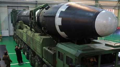Kim Jong-un views the Hwasong-15 ICBM. Picture: KCNA/KNS via AP