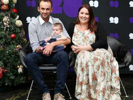 Nathan Lyon, Mel Waring and their first daughter Harper in 2013.