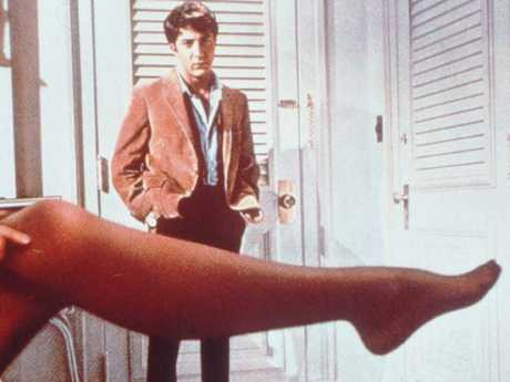 Hoffman looks over the stockinged leg of Anne Bancroft in the 1967 film