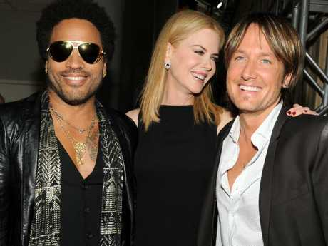 Singer Lenny Kravitz, left, actress Nicole Kidman and country singer Keith Urban. Picture: AP