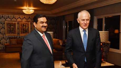 Australian Prime Minister Malcolm Turnbull (right) meets with India's Adani Group founder and chairman Gautam Adani in New Delhi, India, Monday, April 10, 2017. (AAP Image/Mick Tsikas)