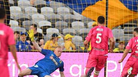Mariners goal keeper Tom Glover saves. (AAP Image/Dean Lewins)