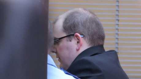 Derek Barrett is led into the Supreme Court for a sentencing hearing. Picture: John Grainger