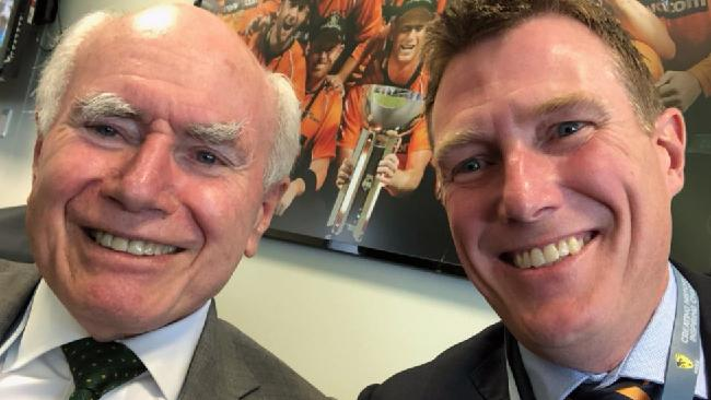 Christian Porter tweeted a selfie with former PM John Howard from the cricket on Thursday. Picture: Twitter Royal commission set to be handed down