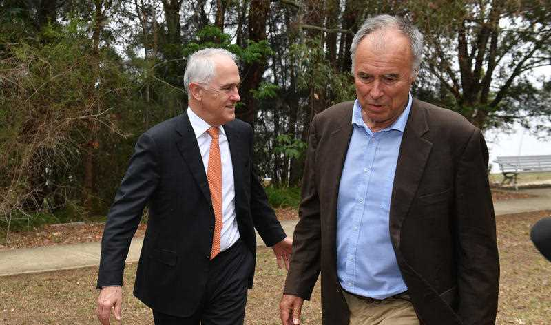 Prime Minister Malcolm Turnbull and Liberal candidate for Bennelong John Alexander arrive at a press conference at Epping in Sydney, Friday, December 15, 2017.
