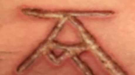 Cult members are allegedly branded with initials like this.  Picture:  Supplied