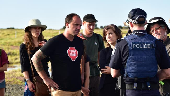 A supplied image obtained on Wednesday, December 6, 2017 of NSW Greens MPs Jeremy Buckingham (2nd left) and Dawn Walker (3rd right) during a blockade of the Adani Carmichael coal mine rail construction. (AAP Image/Supplied by Jeremy Buckingham)