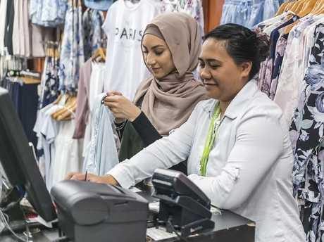 Ms Mohamed and New Zealander Claudia Terangi say there's often 'drama' outside the women's clothing store where they work. Picture: Sarah Keayes