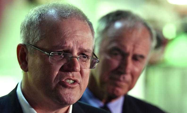 Treasurer Scott Morrison (left) and Liberal candidate for Bennelong John Alexander at a press conference after visiting an Ultra Tune outlet in North Ryde in Sydney, Monday, December 11, 2017.