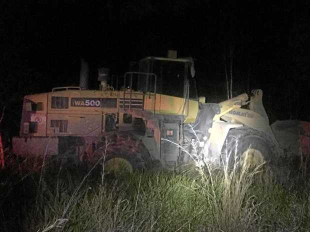 FAMILY TENSIONS: The front-end loader driven Brett Evans drove on the Bruce Highway while drunk.
