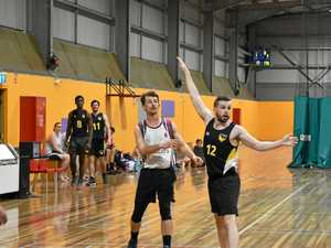 USQ player Bob Ashford can only look on as Warwick's Dom Cremasco nails a three in the Big Q grand final.