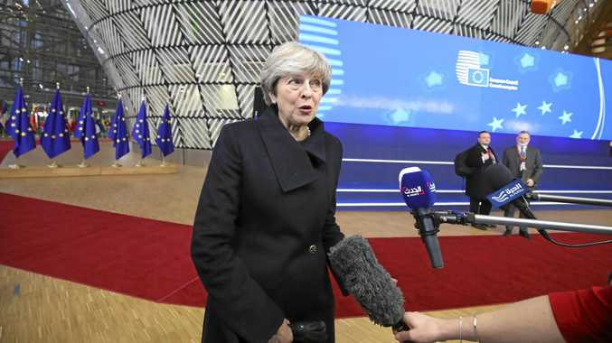 British Prime Minister Theresa May speaks with media last week as she arrives for an EU summit at the Europa building in Brussels.